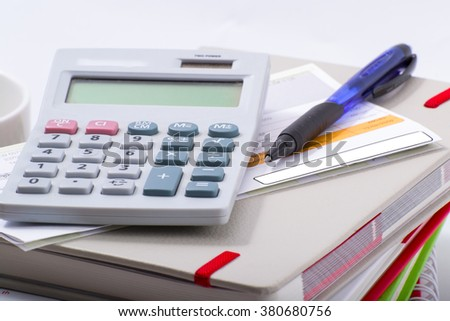 Accounting tools and bills on the table. - stock photo