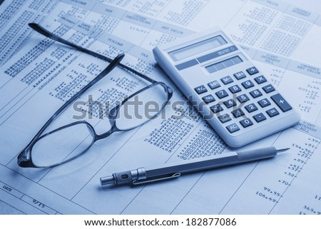 accounting work space with calculator, profit and loss statements - stock photo