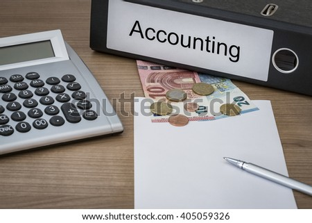 Accounting written on a binder on a desk with euro money calculator blank sheet and pen