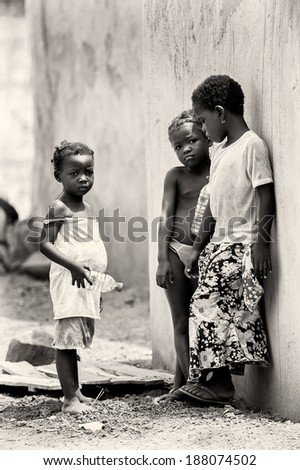 ACCRA, GHANA - MAR 5, 2012: Unidentified Ghanaian girls in the street. People of Ghana suffer of poverty due to the difficult economic situation