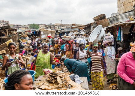 ACCRA, GHANA - MARCH 4, 2012: Unidentified Ghanaian people at the market in Ghana. People of Ghana suffer of poverty due to the unstable economic situation - stock photo