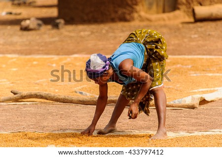 ACCRA, GHANA - MARCH 6, 2012: Unidentified Ghanaian  woman works in the field in Ghana. People of Ghana suffer of poverty due to the unstable economic situation