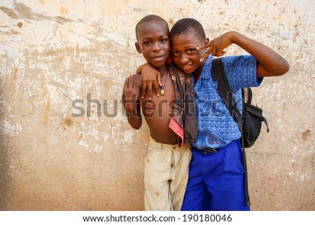 ACCRA, GHANA - MARCH 18: Unidentified young african boys  pose with peach sign hand on March 18, 2014 in ACCRA, Ghana. Ghana is one of the most popular tourists destination in Africa. - stock photo