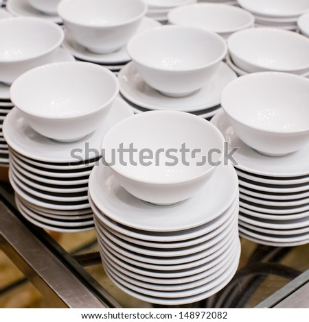 Accurate pile stack of the round ceramic white empty copyspace dish plates