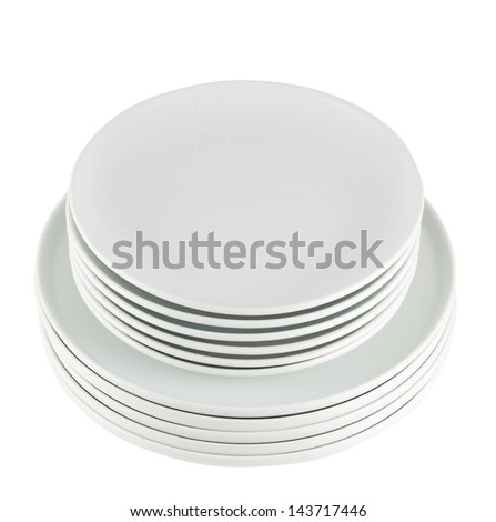 Accurate pile stack of the round ceramic white empty copyspace dish plates isolated over white background, view above - stock photo
