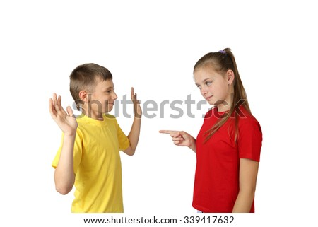 Accusation and acquittal gesture - teenage boy and girl in yellow and red t-shirts stand in full height isolated on white background - stock photo
