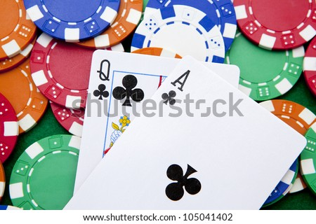 Ace and queen with poker chips in background. - stock photo