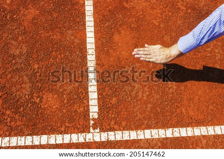 Ace. Ball is IN. Chair umpire check and call in by hand sign. - stock photo
