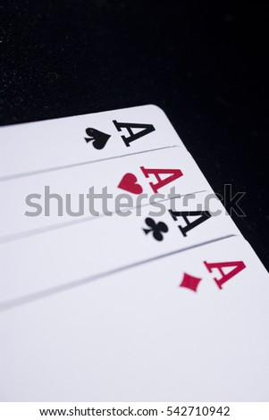 ace four of a kind poker card on dark black background