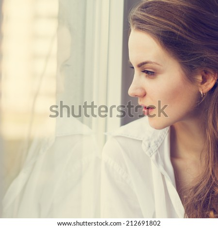 ace lovely blonde at the window - stock photo