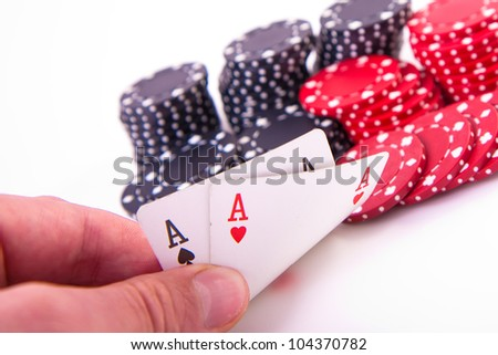 ace of hearts and black jack with poker chips on white background - stock photo