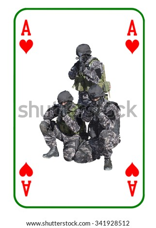Ace of Hearts in combat. Special unit to fight terrorists. Cards are dealt on the table. - stock photo
