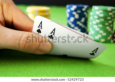 Aces and chips on a gambling table - stock photo