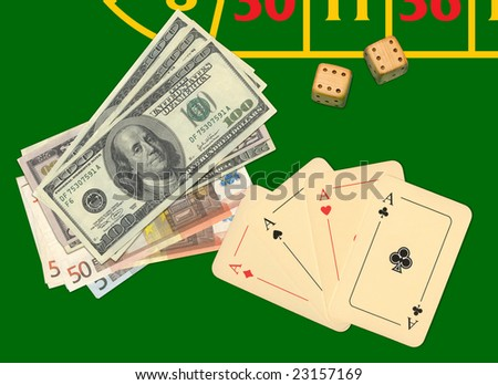 Aces, money and bones on playing table - stock photo