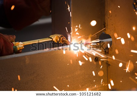 acetylene torch cutting metal - stock photo