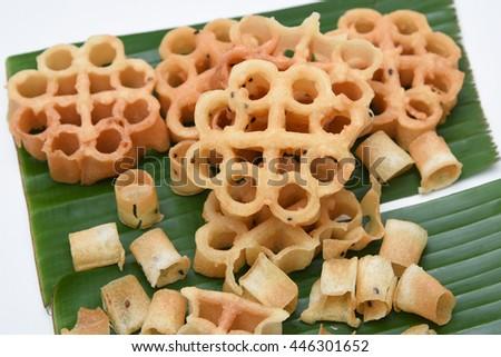 Achappam, popular deep fried traditional South Indian tea time snack on banana leaf, Kerala India.  Home made food/nibbles in coconut oil on Onam, Vshu, Diwali/Deepawali, Ramzan, Eid. sweet crunchy. - stock photo