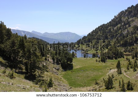 Achard Lake in alpine Belledonne massif, Chamrousse ski center, near Grenoble city, France. - stock photo