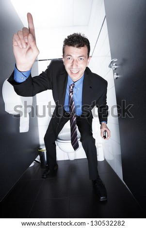 achieving a business deal from the toilet - stock photo
