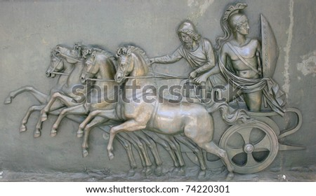 Achillion, Corfu island, Greece - June 22nd, 2010 - Wall art relief in bronze on entrance of summer residence of Austrian emperes Elisabeth. Relief represent Achilles on war chariot