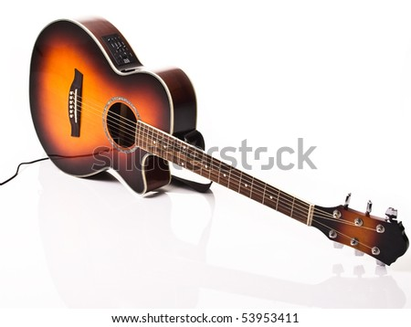 Acoustic and electric guitar with white and power cable - stock photo