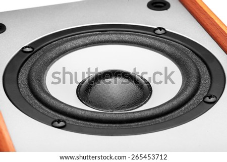 Acoustic column of gray color with finishing under a tree on a white background, the white loudspeaker with a black subweight and a black dome. The isolated image, nobody. - stock photo