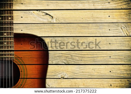 acoustic guitar art on wooden wall - stock photo