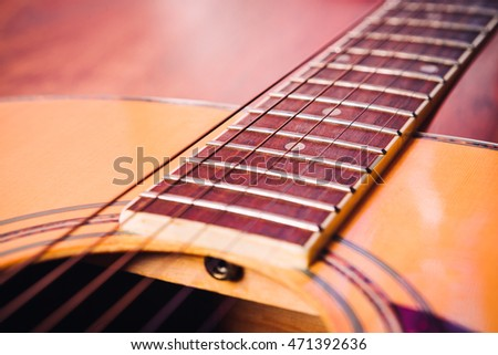 acoustic guitar detail  strings vulture on a light background