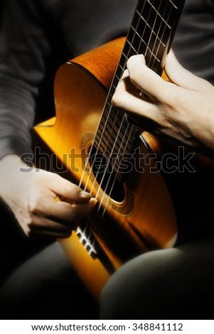Acoustic guitar hands guitarist playing classical guitar player music instrument closeup