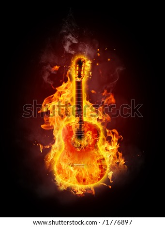Acoustic guitar in fire and flames - stock photo