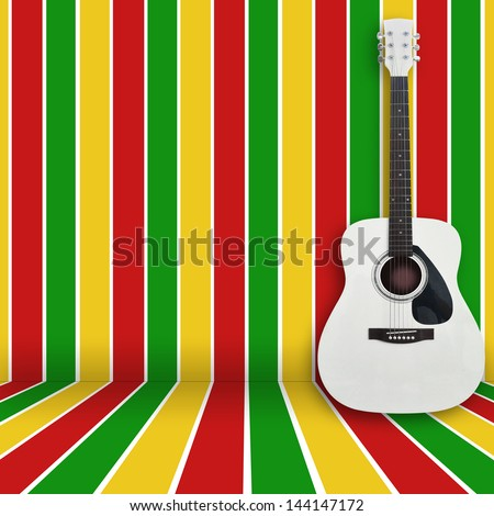 acoustic guitar leaning against the wall - stock photo