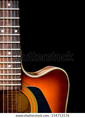 acoustic guitar on a black - stock photo