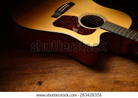 Acoustic guitar on old wooden background - stock photo