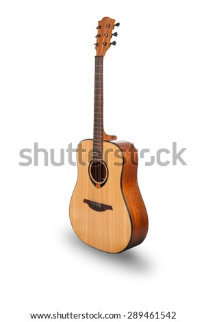 Acoustic guitar with shadow over white background - stock photo