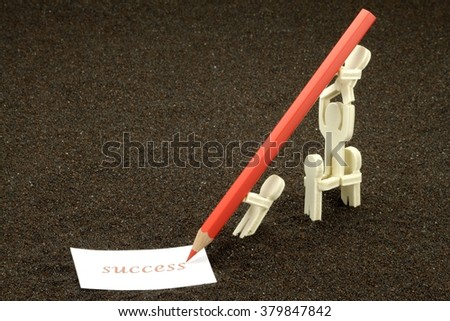 Acrobatic figures of wood write the word Success - stock photo