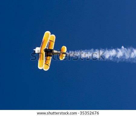 Acrobatic Plane in Flight - stock photo