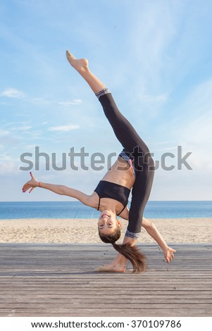 acrobatic skill, young gymnast practice - stock photo