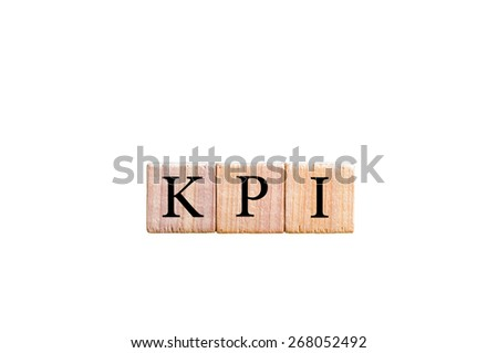 Acronym KPI - key performance indicator. Wooden small cubes with letters isolated on white background with copy space available. Business Concept image. - stock photo