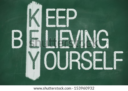 Acronym of KEY. Believe in yourself written in chalk on a blackboard - stock photo