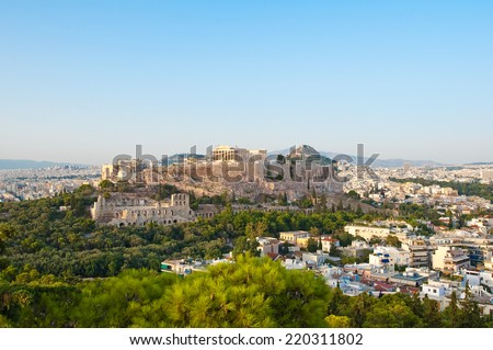 Acropolis of Athens and Lycabettus Hill on the background as seen from Filopappos Hill. - stock photo
