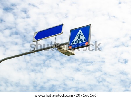 across road sign with blue sky - stock photo