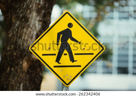 across the road sign. - stock photo
