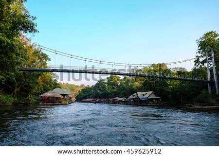 Across the suspension bridge river,Thailand - stock photo