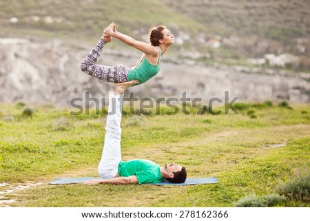 Acroyoga - Balancing on Feet - stock photo