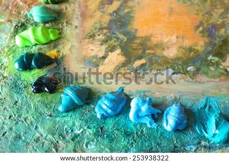Acrylic paint on wooden palette - stock photo