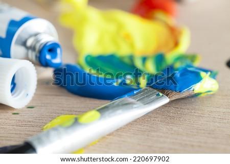 acrylic paint, paint tube and brush - stock photo