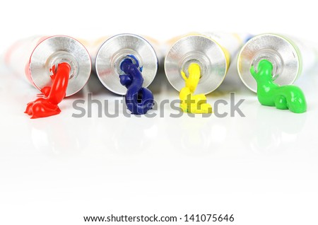 acrylic paints with paint coming out of them - stock photo
