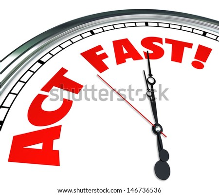 Act Now words on a clock to implore you to take action urgently to take advantage of a special limited time offer or beat a deadline or timeline - stock photo