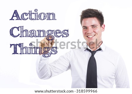 Action Changes Things ACT - Young smiling businessman writing on transparent surface