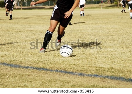 Action in a youth soccer game. - stock photo