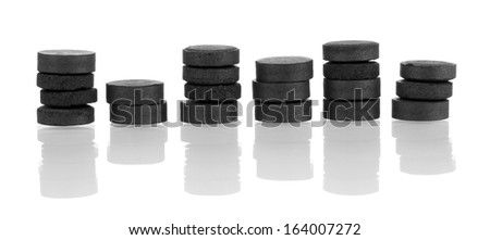 activated carbon in tablets isolated on white